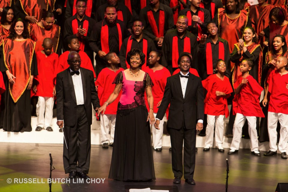 From left to right: prolific arranger and educator Desmond Waithe; Artistic & Musical Director Gretta Taylor; and Assistant Musical Director Dr Roger Henry take the curtain call at a Marionettes Christmas concert